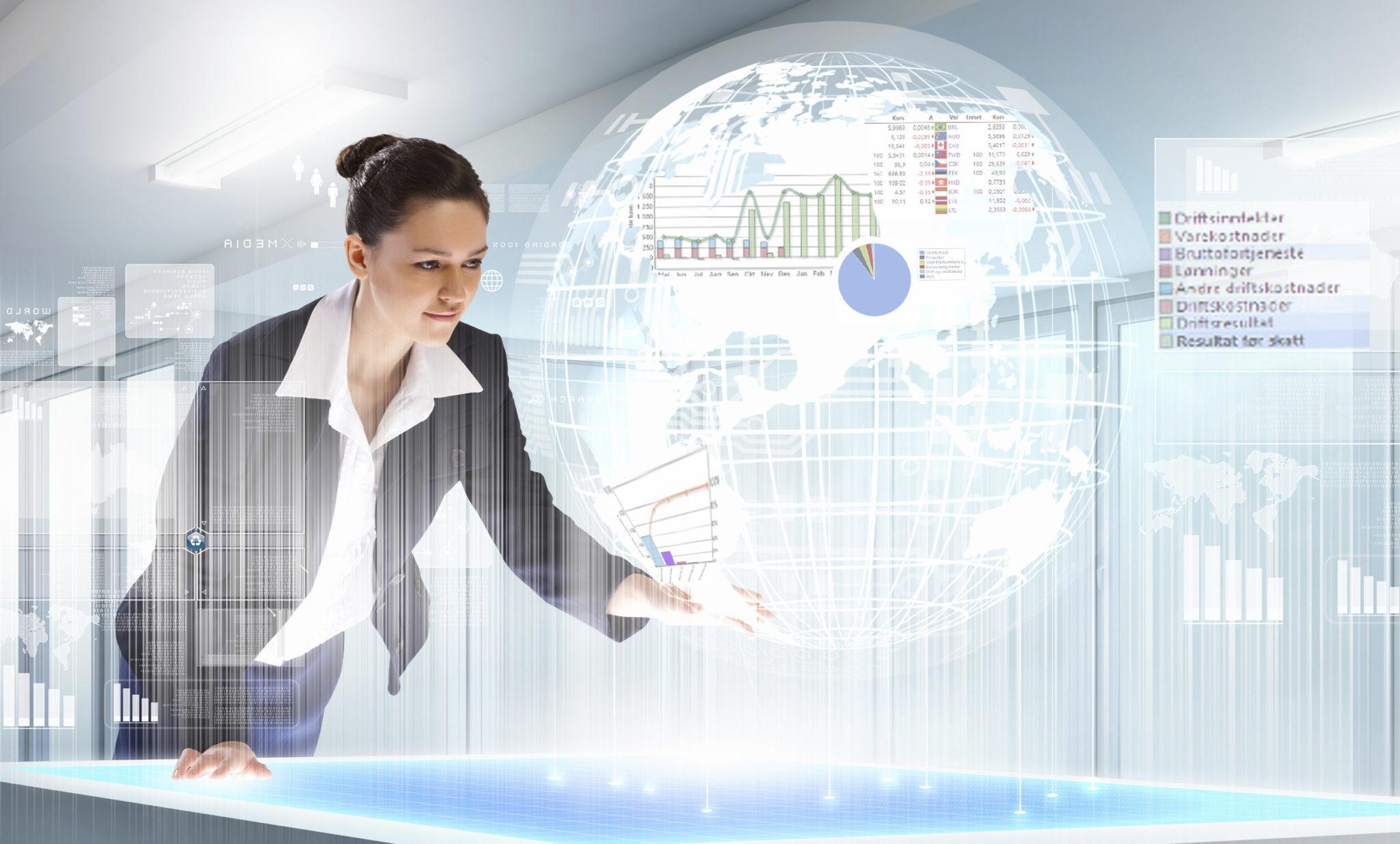 Futuristisk bilde av en kvinne som jobber med Xledger.