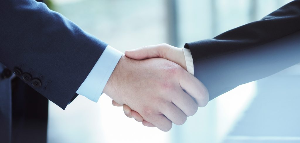 Xledger shaking hands