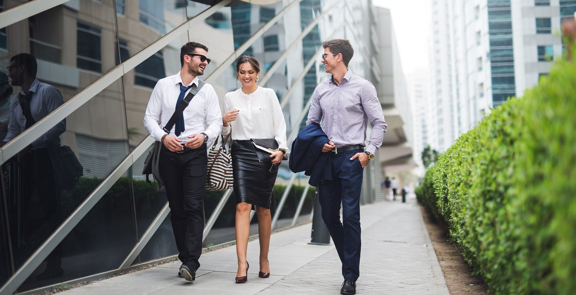 Business men and woman walking